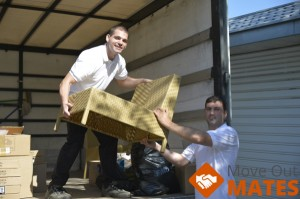two movers loading a truck