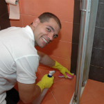 Cleaning the bathroom tiles